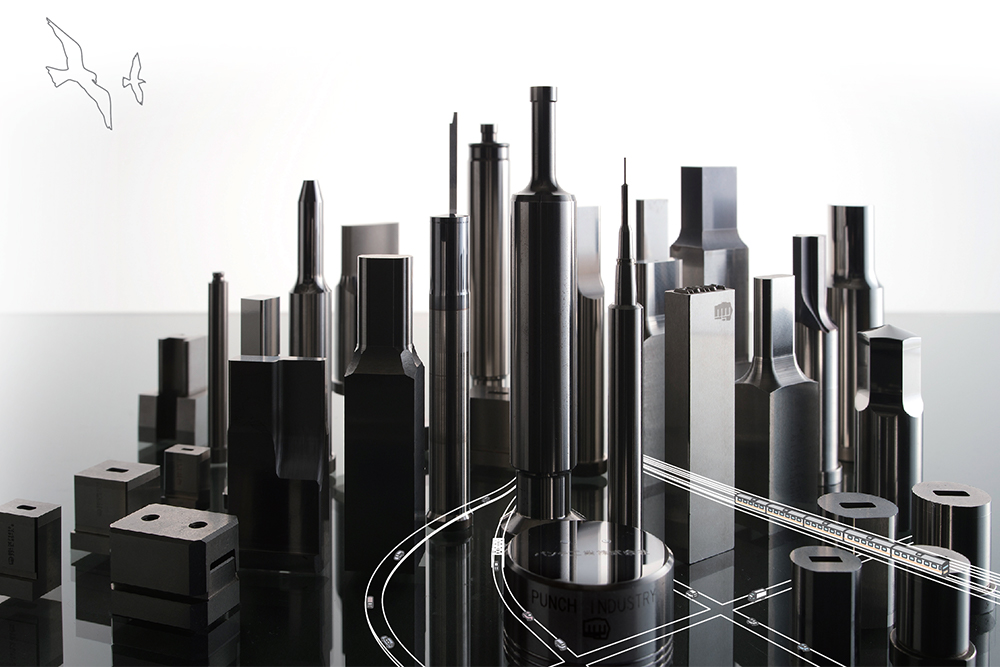 PUNCH mold & die components positioned to form a city skyline